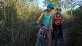 gps : Two young women use GPS Navigation At Smartphone On Bicycle while Cycling in nature