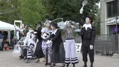 grotesque : JYVASKYLA, FINLAND - AUGUST 17, 2018: Theater troupe Option shows a street performance pantomime Arrival of the train during the international theatre festival Art-Workshop