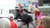 grotesque : JYVASKYLA, FINLAND - AUGUST 17, 2018: Theatre from Estonia Royal Giraffe shows street performance Clown-power during the international theatre festival Art-Workshop Stock Footage