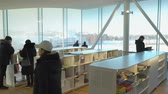 helsinki : HELSINKI, FINLAND - JAN 12, 2019: Helsinki City Central Library Oodi is a new cultural and media hub and a non-commercial, urban public meeting space opening to all. Its modern building with its glass and steel structures and wooden facade
