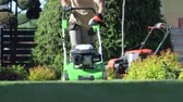 meslek : Caucasian Gardener Mowing Backyard Garden Grass Field. Stok Video