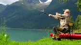 çubuk : Fisherman in His 30s Fly Fishing on the Scenic Lake. Slow Motion