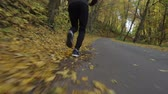 kocogás : Jogging in the Park. Men Running on the Paved Road. Scenic Fall Foliage.