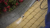yıkayıcı : Garden Cleaning Work with Powerful Pressure Washer. Cleaning Cobble Stone Path Element