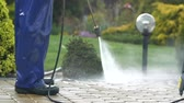 yıkayıcı : Slow Motion Footage of Men Washing Garden Paths Using Power Washer.
