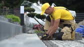bloc de pierre : Path Brick Paving Closeup with Some Workers in the Background. Vidéos Libres De Droits