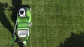 quintal : Professional Gardener in His 30s with His Gasoline Lawn Mower. Professional Summer Landscaping Works. Aerial Footage.