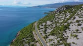 hırvat : Aerial Footage of Croatian Scenic Coastal Highway and Turquoise Waters of the Mediterranean Sea