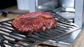 sığır eti : Fresh and Hot Beef Meat Steak. Cooking Inside Gas Heating BBQ Cooker.