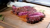 ベーキング : Food Industry. Slicing and Eating Fresh Cooked Tom-A-Hawk Steak.