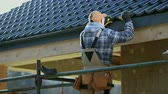 okładka : Roofing Industry. Ceramic Tiles House Roof Construction. Contractor Worker on Scaffolding. Wideo