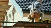 Industrial Worker Finishing Ceramic Roof Tiles Cover. Last Check. Caucasian Contractor in His 30s. Stockvideo