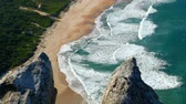 wydmy : view from top of rocks to sandy beach and waves