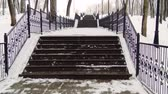 arasz : Climbing the snow-covered winter stairs in the city Park. Stock mozgókép