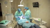 confident : Surgeon team working together in a surgical room Stock Footage