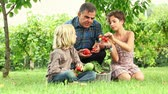cesta : Adult Farmer with Children and Harvested Vegetables
