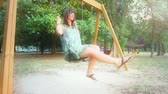 campus : Young Woman Having Fun on the Swing