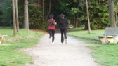 outdoor pursuit : Two Young Women Running at Park