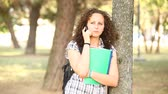 campus : Beautiful Young Student with Mobile Phone at Park Stock Footage