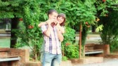 campus : Young Couple Playing at Park Stock Footage