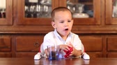 months : Little Child Eating Sweet Biscuits Stock Footage