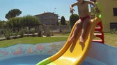 piscina : Little Boy Having Fun on Small Swimming Pool Vídeos
