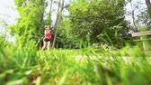 exhausted : Beautiful Young Woman Having a Rest while Jogging Stock Footage