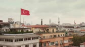 tarihsel : Turkish Flag and Istanbul Rooftops View with Mosque on Background Stok Video