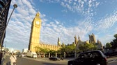 yönetme : LONDON, UK - AUGUST 21, 2015: Timelapse view of Big Ben and Westminster, with traffic and people passing on the road Stok Video