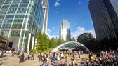 doca : LONDON, UK - AUGUST 21, 2015: Commuters and tourists in Canary Wharf main square, time lapse
