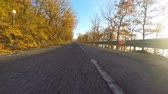 automóvel : Car driving a countryside road on a sunny day. Video taken with an action camera from the bottom front of the vehicle. There is a blue sky with clouds, travel and transportation concepts.