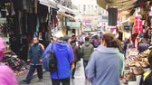 local : ISTANBUL, TURKEY - OCTOBER 27, 2014: People walking in the street and looking at local market shops. There are people with different ethnicities and wearing dirrent style of clothes