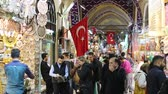 hlavní : ISTANBUL, TURKEY - OCTOBER 27, 2014: People at Grand Bazaar, themain market of the city, with Turkish flags in front of some shops. There are people with different ethnicities and wearing dirrent style of clothes