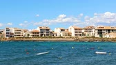 baía : Houses on seaside town in Majorca, panoramic view on a sunny day. Small boats and sea on foreground, clouds on the sky on background. Travel and vacations concepts