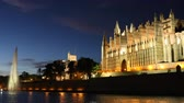 church : Cathedral in Palma de Majorca at night. Panoramic view of the famous cathedral with lake and fountain on foreground. Architecture and travel concepts