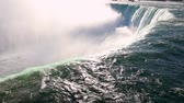 longo : Niagara Falls view from the top. Close up of the beautiful horse shoe fall at Niagara, from the Canadian side. Very famous and majestic destination Stock Footage