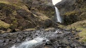 rega : Waterfall and creek in Iceland. Tranquil scene, nobody, nature concepts in the Icelandic countryside.