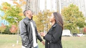 diversão : Happy black couple laughing at park Stock Footage