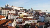 дом : Lisbon roof panoramic view on a sunny day. Colourful warm view of the capital city of Portugal with houses and churches. Travel and architecture concepts Стоковые видеозаписи