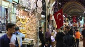 hlavní : ISTANBUL, TURKEY - OCTOBER 27, 2014: People at Grand Bazaar, the main market of the city, with Turkish flags in front of some shops. There are people with different ethnicities and wearing dirrent style of clothes
