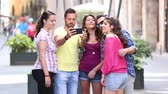 Group of friends taking a selfie in the city on a summer day. They are young and happy, and they could be tourists or students. Friendship and lifestyle concepts Wideo
