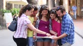 típico : Tourists looking at city map with typical Italian street on background. Five persons, friends, visiting a city together on a trip. Teamwork and lifestyle concepts Vídeos