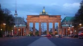 Berlin Brandenburg gate at night, time-lapse with traffic lights trails. Berlin tv tower on background. View from the west side of Berlin. German name is Brandenburger Tor Wideo