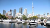 Toronto skyline view with pier on foreground. Modern buildings and skyscrapers in Toronto, the capital city of Ontario, Canada, with boats on foreground. Architecture and travel. Wideo