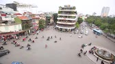 HANOI, VIETNAM - NOVEMBER 20, 2017: Aerial time lapse view of traffic at a busy city junction. Hanoi is famous for mopeds and motorbikes traffic and traffic jams in general