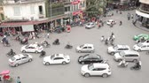 HANOI, VIETNAM - NOVEMBER 20, 2017: Aerial view of traffic at a busy city junction. Hanoi is famous for mopeds and motorbikes traffic and traffic jams in general Wideo