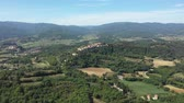 Aerial view of green hills and countryside in Italy - Bird eye view of beautiful landscapes on a sunny summer day - Travel and nature concepts
