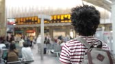 Man walking to the train at station, slow motion - Curly mixed race man on a trip, seen from behind - Travel and lifestyle concepts Wideo