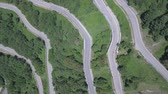 passar : Aerial view of a winding mountain road in Italy. Green woods along a scenic and beautiful road leading to Bocca Trabaria pass on a sunny day