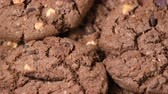 Oatmeal cookies with cocoa, chocolate and hazelnuts rotating close-up